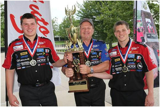 Brik Wisniewski, left, and Anthony Critcher, right, pictured with Eldridge Watts, finished third in the Ford/AAA Student Auto Skills National Finals.