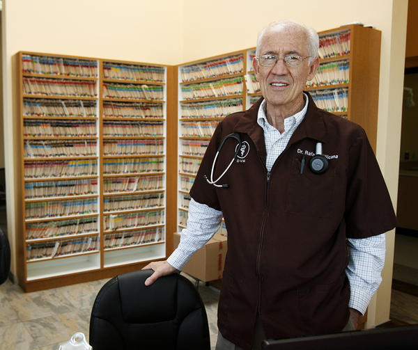 Veterinarian Dr. Rafael Villicana in his newly added front desk and waiting area at the recently remodeled and expanded Gateway Animal Hospital in Glendale on Wednesday, June 12, 2013.