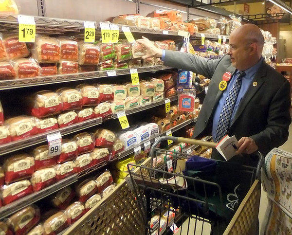Rep. Mark Pocan (D -Wis.) buys food at a Washington, D.C., supermarket as part of a challenge to live on $4.50 in daily food expenses. A group of Democratic representatives are protesting possible cuts to the food stamps program.