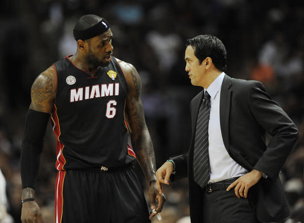 Miami Heat coach Erik Spoelstra talks with LeBron James during the first quarter of Game four of the NBA Finals against the San Antonio Spurs, Thursday, June 13, 2013, at the AT&T Center in San Antonio.
