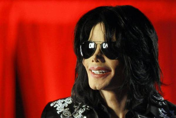 "In this photo taken three months before his death in June 2009, Michael Jackson speaks at a news conference in London. His tour director at the time, Kenny Ortega, emailed AEG Live executive Randy Phillips that the pop singer was ""trembling, rambling, obsessing"" and eventually needed a mental health evaluation."