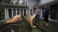 At least two people died Thursday after a wide line of storms swept through the Ohio Valley and into the mid-Atlantic.