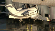 A jet smashed into a hanger at Chino Airport on Thursday evening while mechanics were conducting an engine run-up test, a Federal Aviation Administration spokesman said.
