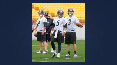 Pittsburgh Steelers quarterbacks John Parker Wilson, (4), Bruce Gradkowski (5) and Landry Jones (3) line up to start drills during NFL football practice in Pittsburgh. The Steelers signed Jones to a four-year contract on Thursday.
