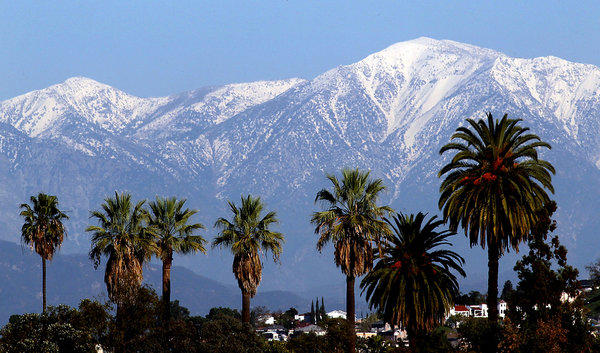 Snow dusts the San Gabriel Mountains. Climate change could dramatically reduce the amount of snow that falls on Southern California mountains, making scenes like this rarer.