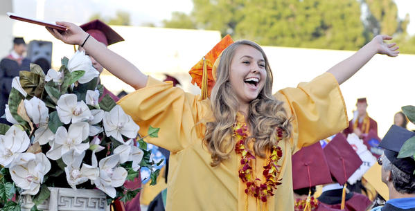 A graduate celebrates after receiving her diploma during the La Cañada High School commencement on Thursday, June 13, 2013 in La Cañada.