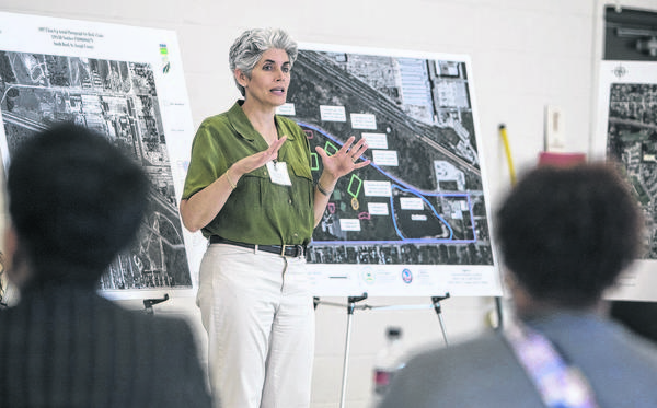 Janet Pope, EPA Community Involvement Coordinator, speaks to local residents during a U.S. EPA and the Indiana Department of Environmental Management forum regarding Beck's Lake health concerns on Thursday, June 13, 2013 at the Charles Black Center in South Bend.