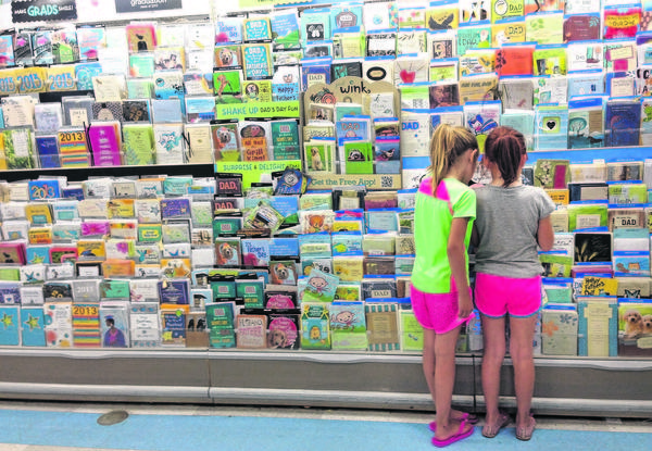 Mackenzie Campbell, left, and Melena Houser Estrada, both 7, shop for Father's Day cards Thursday at Meijer, 5020 Grape Road, Mishawaka.