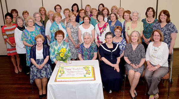 "Members of the Waynesboro College Club gathered around a large birthday cake to commemorate eight decades of raising scholarship funds. Club members present are pictured, from left, first row (seated), Judy Maxwell, Janet Smedley, Marie ""Maisie"" DiGiammarino, Barbara Bowersox, Karen Walters, Marie Lanser Beck, Sandy Beaumont; second row, Patricia Blubaugh, Marge Kiersz, Barbara Gaydick, Connie Fleagle, Debbie Pflager, Betty Emery, Judy Hofmann, Doris Spangler, Karen Herald, Holly Carey; third row, Charlene Good, Rebecca Harris, Mary Jo Kowallis, Bonnie Bachtell, Eunice Statler, Chris Bradley, Sue Von Rembow, Ruth Strausbaugh, Grace Brown; back row, Elena Kehoe, Jill Kessler, Kim Morrison, Nancy Mace, Pat Groff, Dawn Keller, Andrea Bowersox and Sara Yost."