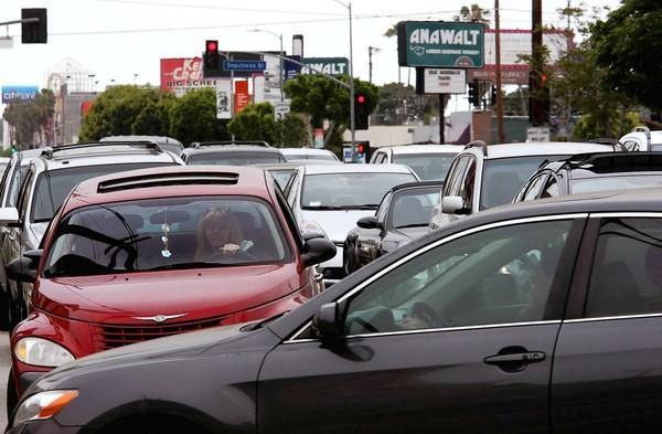 A car is caught in cross-traffic along Pico Boulevard between Sepulveda and Sawtelle boulevards.