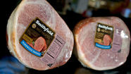 (Reuters) - Hog producer Smithfield Foods Inc , the subject of a $4.7 billion bid from China's Shuanghui International, posted a 63 percent fall in net profit as exports to China and Russia fell due issues related to a drug it uses to produce lean meat.