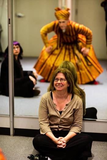 "Mary Zimmerman, center, and costume designer Mara Blumenfeld  watch as Larry Yando is fitted with the costume of  Shere Khan for the Goodman Theatre production of ""The Jungle Book."""