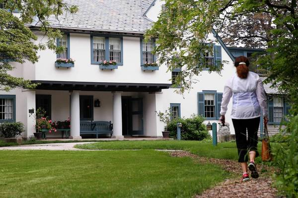 A visitor walks up the path towards the Ragdale House at the Ragdale artist's retreat in Lake Forest.