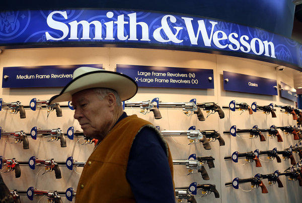 Smith & Wesson said its fourth-quarter results may exceed Wall Street expectations. Above, a Smith & Wesson display at the National Rifle Assn.'s annual meeting in Houston in May.