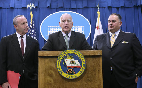 Gov. Jerry Brown discusses the budget agreement flanked by Senate President Pro Tem Darrell Steinberg (D-Sacramento), left, and Assembly Speaker John Perez (D-Los Angeles) at a Capitol news conference Tuesday. Lawmakers began voting on the deal Friday.