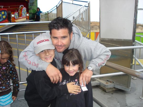 This undated image taken before Bryan Stow was injured in 2011 shows him with his 12-year-old son and 8-year-old daughter.