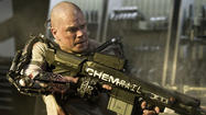 "Sony has released its latest trailer for its sci-fi action pic ""Elysium"" which features Matt Damon delivering big in the action department and even injecting a little humor."
