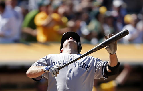 New York Yankees' Kevin Youkilis reacts after being struck out with bases loaded during the eleventh inning of his MLB American League game against the Oakland Athletics at O.co Coliseum in Oakland June 13, 2013. REUTERS/Stephen Lam (UNITED STATES - Tags: SPORT BASEBALL TPX IMAGES OF THE DAY)