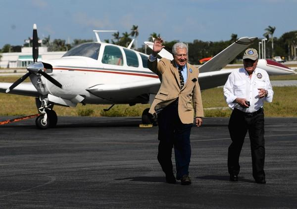 Don Newman, left, president of the United Flying Octogenarians, and Charlie Lopez, vice president of public relations, walk away from Newmans plane at Fort Lauderdale Executive Airport.
