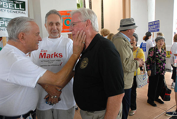 Skip Campbell, right, then a Broward state senator, laughs as Bob Krakow, left, of Tamarac gives him a slap on the cheek while Max Cohn, also of Tamarac looks on as Campbell greeted his supporters at the Kings Point Clubhouse polling location in Tamarac.