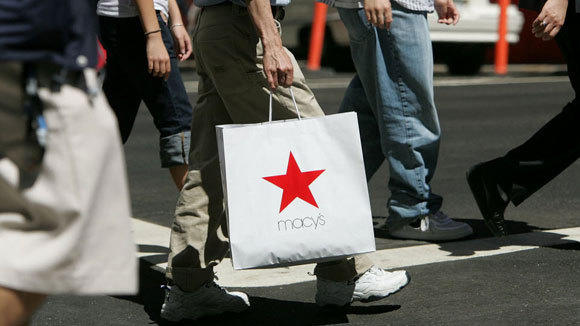 A shopper with a Macy's bag crosses a San Francisco street in a 2007 file photo.