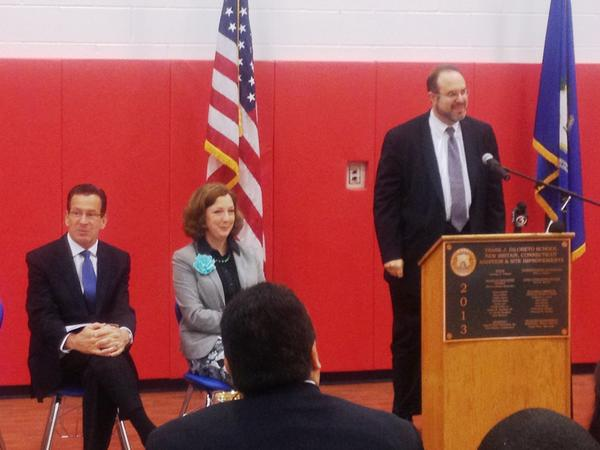 State Education Commissioner Stefan Pryor speaks at the dedication of New Britain's $10 million DiLoreto Magnet School expansion. Gov. Dannel P. Malloy and school board President Sharon Beloin-Saavedra look on.