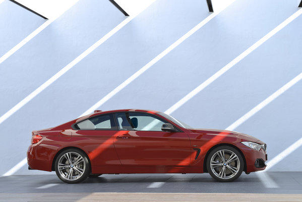 BMW 435i Coup in Sport Line trim. The car uses the same inline six-cylinder engine as the 335i sedan, which makes 300 horsepower and 300 pound-feet of torque.