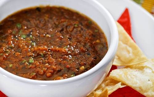 "<a href=""http://www.latimes.com/features/food/la-fo-0615-sos-20130615,0,4163026.story"" target=""_blank"">Costa Azul's salsa is made with six types of pepper.</a>"