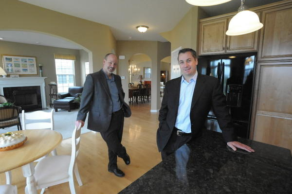 Co-founders John Wozniak, left, and Jim Chittaro of J. Lawrence Homes, at their 2,674-square-foot Riviera model home in Wadsworth's Midlane Country Club subdivision.