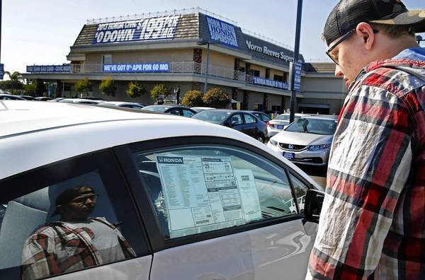 In Cerritos, Matthew Zietara of Hollywood looks at a Honda Civic at Norm Reeves Honda. The Civic is one of the most-leased cars in the U.S.; the carmaker has pushed hard to get consumers into leases.