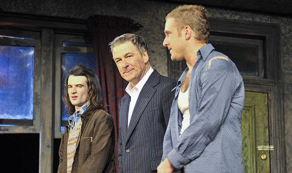 "Alec Baldwin, center, stars in ""Orphans,"" flanked by Tom Sturridge, left, and Ben Foster."