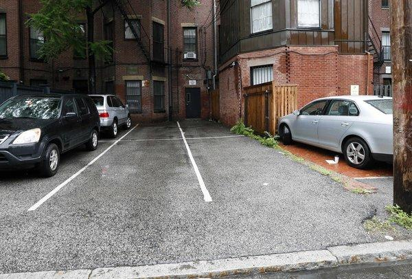The two open parking spaces at right, front and back, in Boston's Back Bay area were sold at auction Thursday for $560,000.