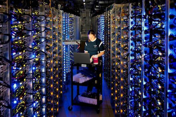 At a Google data center in Oregon, Denise Harwood diagnoses an overheated computer processor. Google uses these data centers to store email, photos, video, calendar entries and other information from its users.