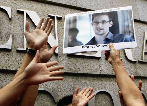 A supporter holds a picture of Edward Snowden outside the U.S. Consulate General in Hong Kong on June 13.