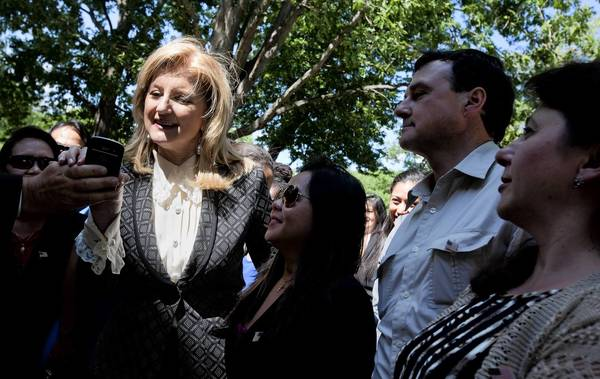 Arianna Huffington, the columnist who founded the Huffington Post, poses for a photo with new citizens on Friday in Williamsburg.