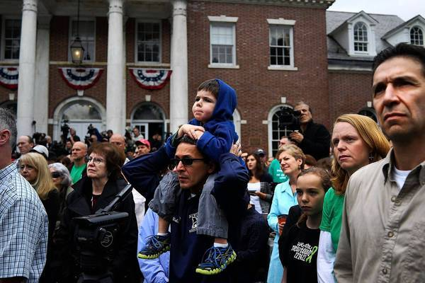 An event is held in Newtown, Conn., in honor of the Sandy Hook victims. A 26-second moment of silence was observed to remember the 20 children and six adults killed at the school.