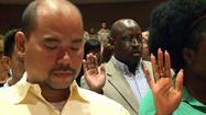 Dozens of men and women from around the world took an oath Friday morning and pledged to uphold their new responsibilities as Americans at a naturalization ceremony.