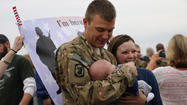 Stationed thousands of miles away in Afghanistan, Illinois National Guard soldier Paul Stansbury was crushed when he missed the birth of his son, Hunter, five months ago.