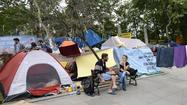 ISTANBUL, Turkey – Anti-government protesters on Saturday vowed to continue their occupation of Gezi Park in central Istanbul, spurning government calls for them to pack up and end two weeks of demonstrations.