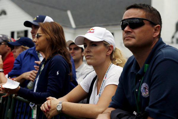 Skier Lindsey Vonn waits near the clubhouse as he watches Tiger Woods on the 18th hole during Round Two of the 113th U.S. Open at Merion Golf Club on Friday.