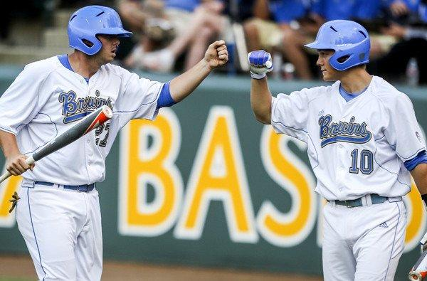 UCLA's Pat Gallagher, left, celebrates with teammate Pat Valaika after scoring a run against San Diego State in a regional game last month at Jackie Robinson Stadium.