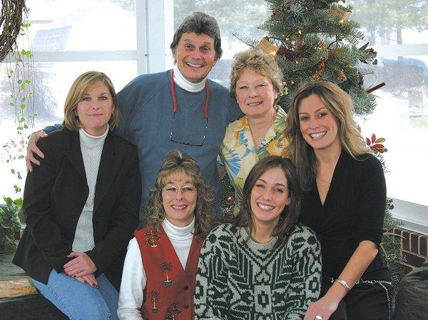 This photo of Sam Rock and his family was taken at Christmas 2005, the familys last Christmas together before the death of Sams wife, Brenda. Pictured, front row, from left, are Tracy and Elizabeth; and back row, Kristi, Sam, Brenda and Sarah.