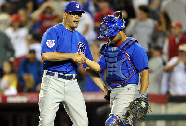 Kevin Gregg and catcher Welington Castillo celebrate the Cubs 8-6 victory against the Angels.