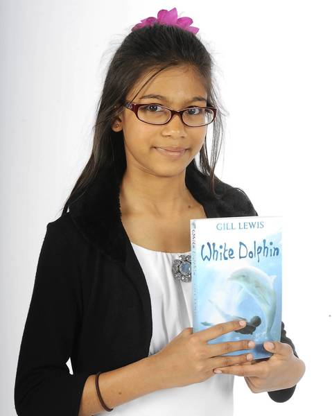 "Audrika Khondaker, 11, of Macungie, with one of her latest reads ""White Dolphin"" by Gill Lewis"