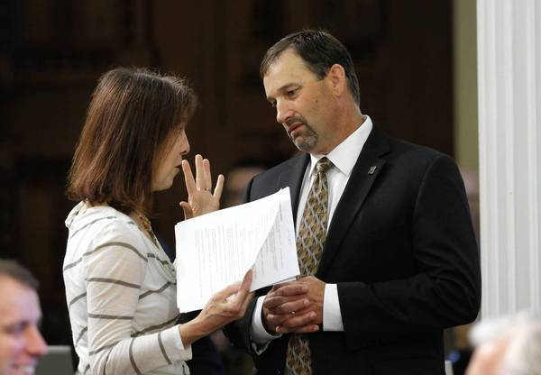 Assemblywoman Nancy Skinner (D-Berkeley), confers with Assemblyman Brian Dahle (R-Bieber) as lawmakers put the finishing touches on California's state budget.