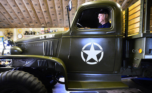 William Glenn Kaplan moves his 1941 U.S. Army truck made by Chevrolet. He and his son Kevin Kaplan began restoring the vehicle over 4 years ago in memory of his father William, who bought the truck from the military in 1946.