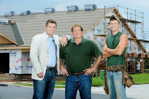 Paul Crampton III, left, Paul Crampton Jr. and Lance Crampton at a construction site at Emerald Pointe.