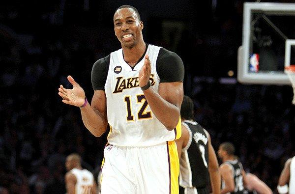 Center Dwight Howard reacts as the Lakers open a lead against the Spurs in the fourth quarter of a game earlier this season.