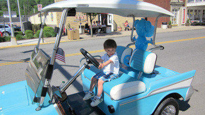 Two-year-old Mikey Sotosky looks as if he is ready to take off in one of the vehicles used during the Miners Memorial Day Festival in Windber. Mikey is the son of Mike and Theresa Sotosky of Davidsville.