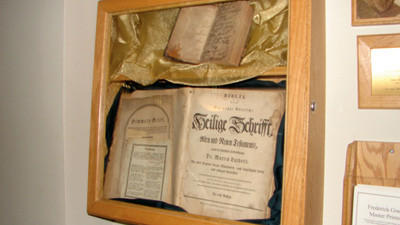 This display case in Somerset Trusts main office holds a Charles Frederick Goeb Bible, the larger book, and a copy of the New Testament.